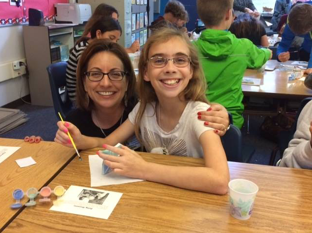 A student and her mother paint butterflies for The Butterfly Project, several years after Paper Clips was shown at DePortola Middle School